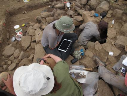 Students using the iPads for in-field data collection in one of the tomb contexts